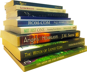 Stack of printed books formatted by Erika Q. Stokes